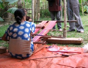 image of a person using a backstrap loom